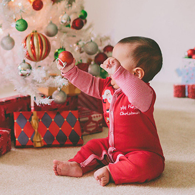 Baby Playing with Christmas Ornament