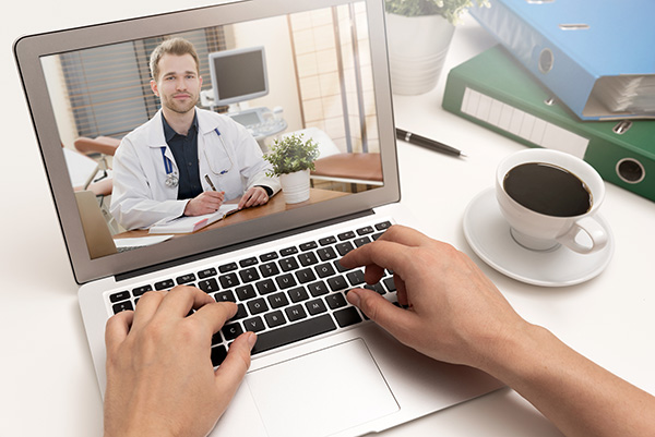 Telemedicine visit with a doctor using a laptop