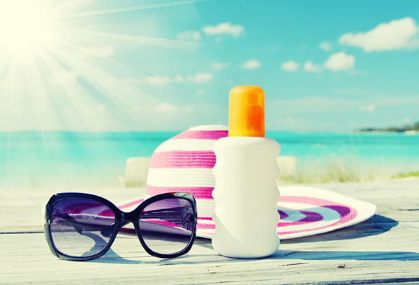 Stay safe in the sun with sunscreen, a hat & sunglasses